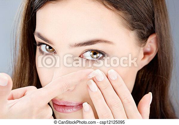 woman putting contact lens - csp12125095