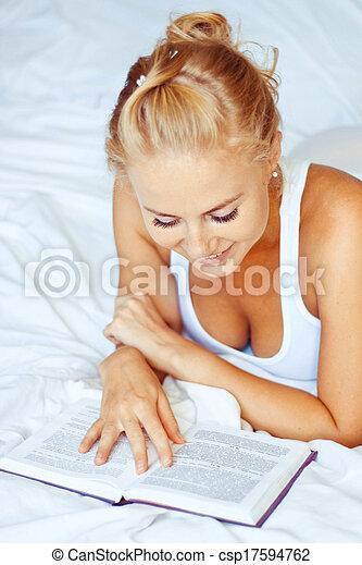 Woman reading a book - csp17594762