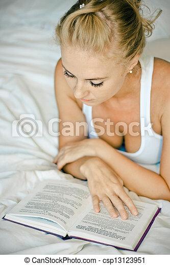 Woman reading a book - csp13123951