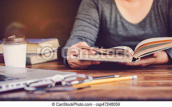 woman reading a book - csp47248059
