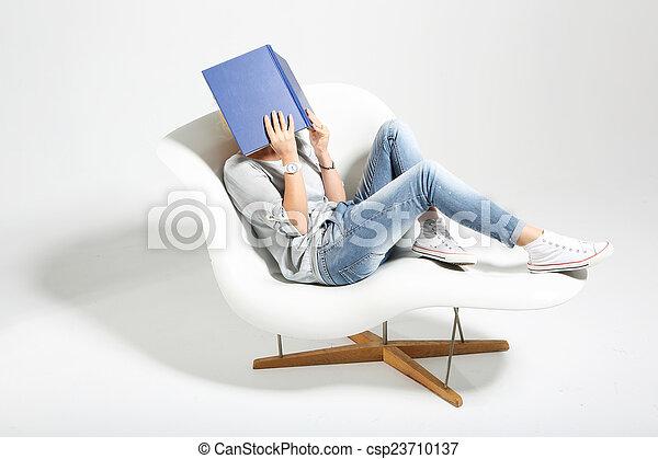 Woman reading a book. - csp23710137