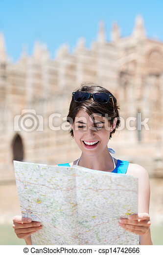 Woman reading a map while on holiday - csp14742666