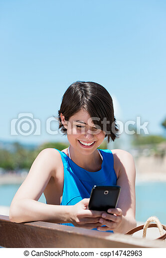 Woman reading an sms on her mobile - csp14742963