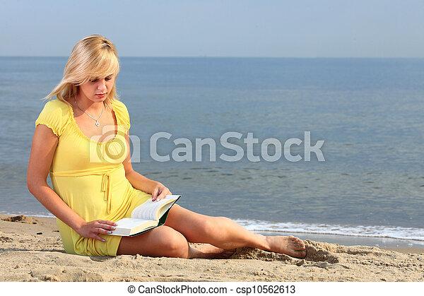 woman reading book girl yellow dress - csp10562613