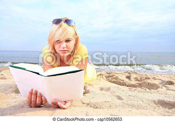 woman reading book girl yellow dress - csp10562653