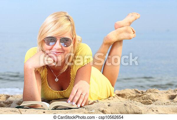 woman reading book girl yellow dress - csp10562654
