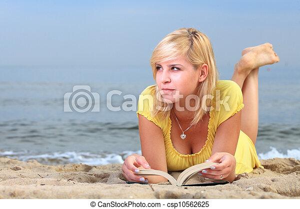 woman reading book girl yellow dress - csp10562625