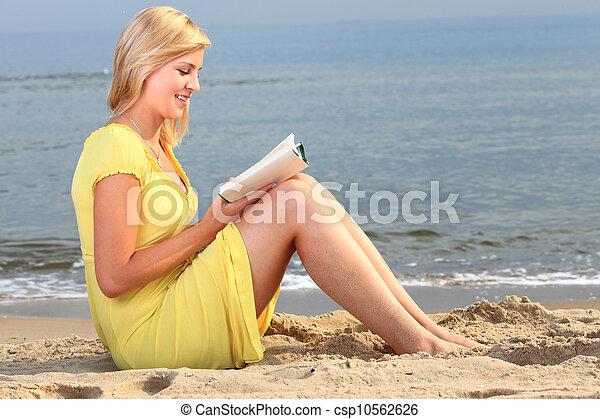 woman reading book girl yellow dress - csp10562626