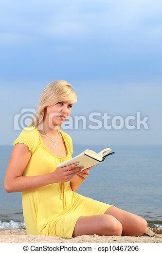 woman reading book girl yellow dress - csp10467206