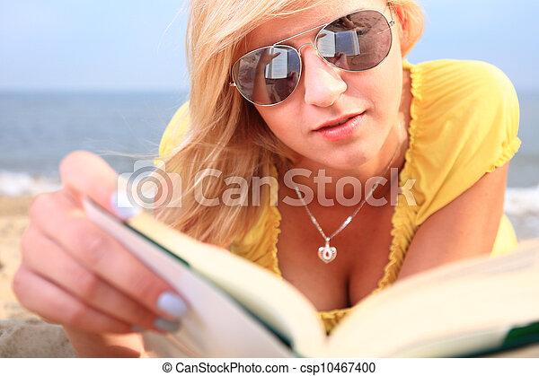 woman reading book girl yellow dress - csp10467400