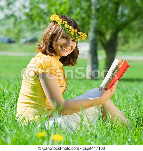 woman reading book in grass - csp4417100
