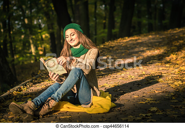 woman reading book in Park - csp44656114