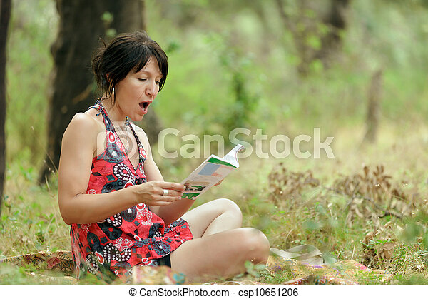 woman reading in nature - csp10651206