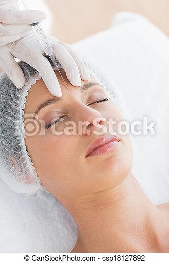 Woman recieving botox injection - csp18127892