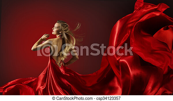 30fd04dc7bab Woman red dress dancing, fashion model flying cloth fabric. Woman in ...