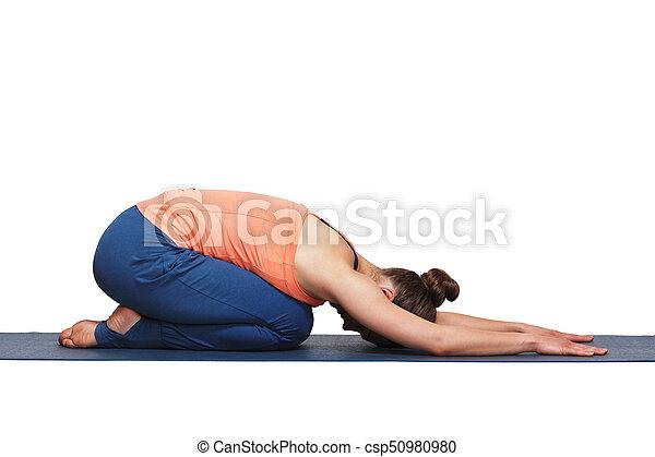 woman relax in hatha yoga asana balasana child pose woman
