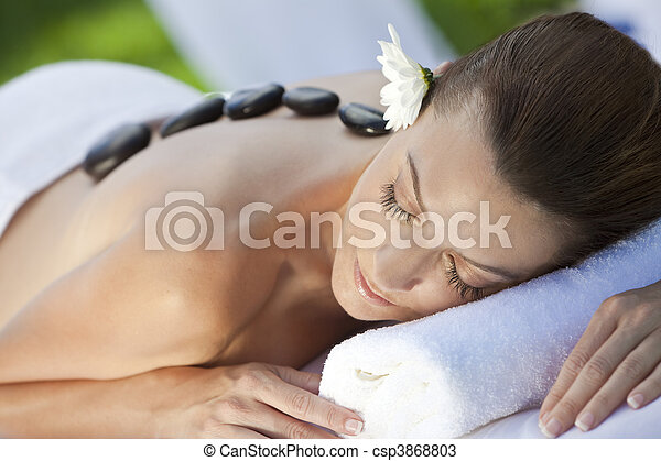 Woman Relaxing At Health Spa Having Hot Stone Treatment Massage - csp3868803