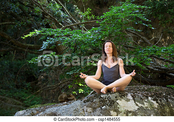 woman relaxing in forest - csp1484555
