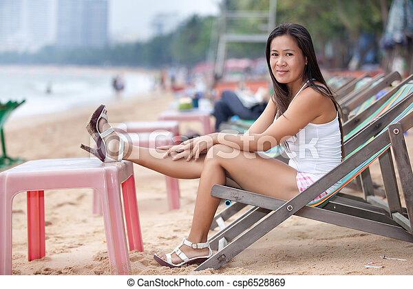 Awe Inspiring Woman Relaxing On Beach Creativecarmelina Interior Chair Design Creativecarmelinacom