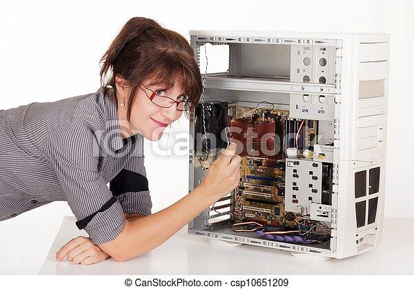 woman repairing computer - csp10651209