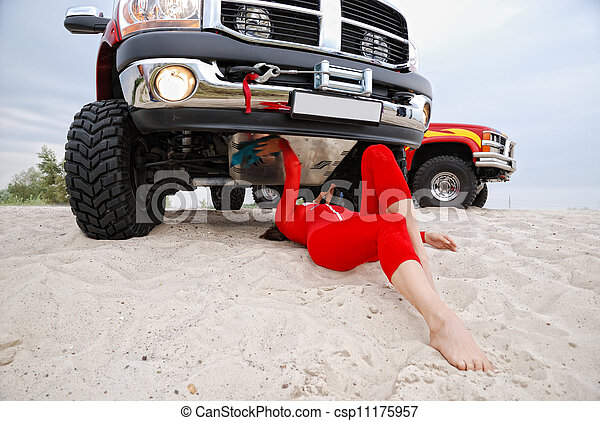 woman repairing the red jeep - csp11175957