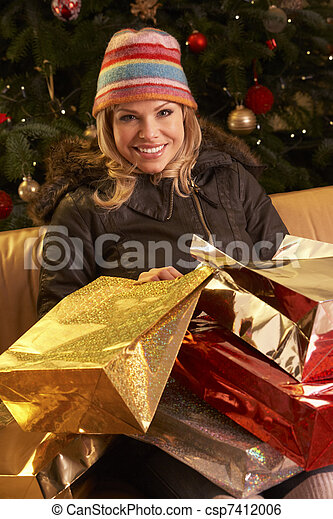 Woman Returning After Christmas Shopping Trip - csp7412006