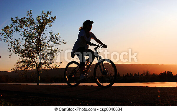 Woman riding a bike - csp0040634