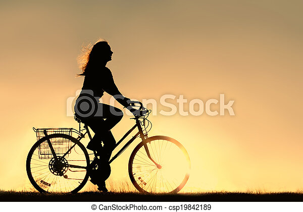 Woman Riding Bicycle Silhouette - csp19842189