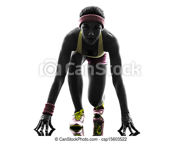 woman runner running on starting blocks silhouette - csp15603522