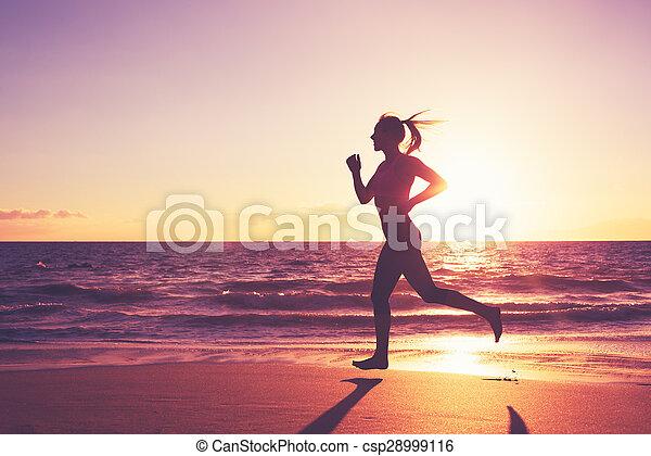 Woman Running at Sunset - csp28999116