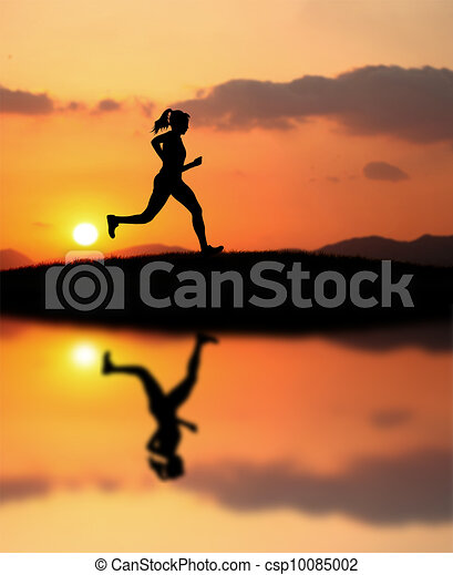 woman running during sunset - csp10085002