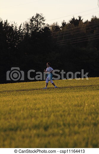 woman running on a meadow - csp11164413