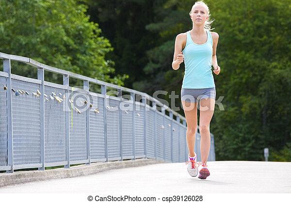 Woman runs outdoor on a bridge as stamina training - csp39126028