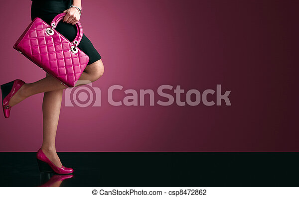 Woman sexy legs with handbag. Shopping and business  - csp8472862