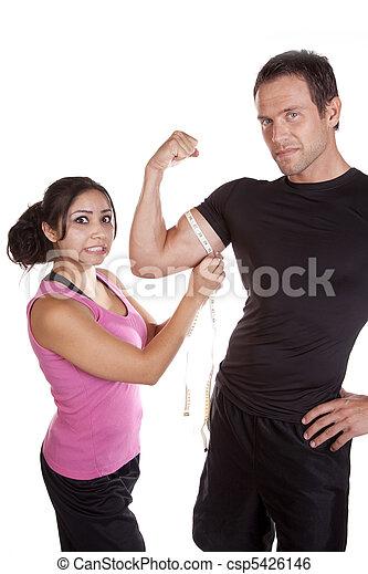 Woman shocked when measuring mans arm - csp5426146