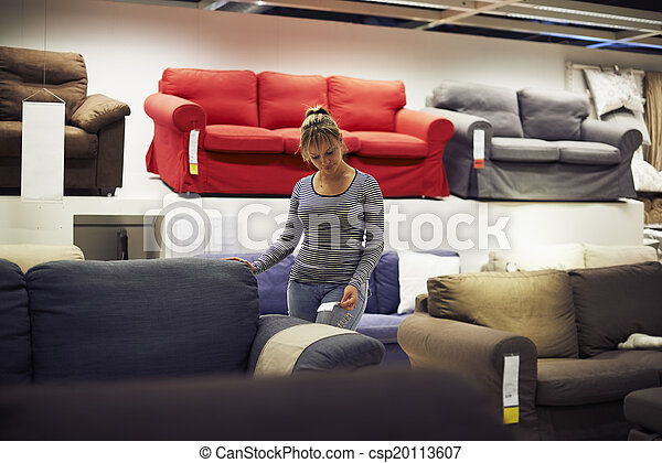 woman shopping for furniture and home decor - csp20113607