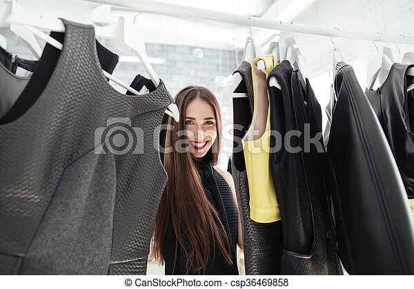 Woman shopping in a clothing store - csp36469858