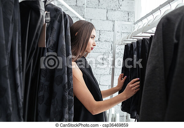 Woman shopping in a clothing store - csp36469859