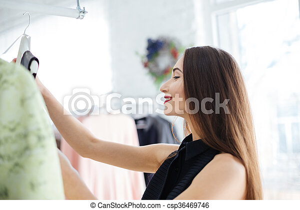 Woman shopping in a clothing store - csp36469746