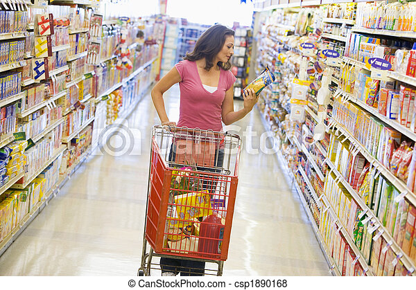 Woman shopping in supermarket aisle - csp1890168