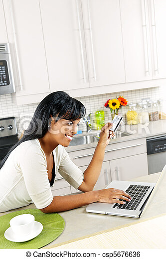 Woman shopping online at home - csp5676636