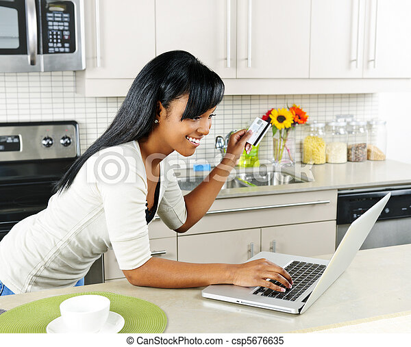 Woman shopping online at home - csp5676635