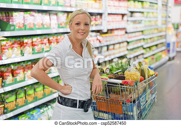 woman shopping with cart in the supermarket - csp52587450