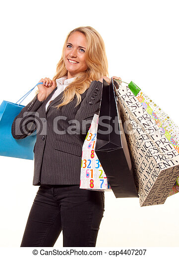 Woman shopping with many shopping bags - csp4407207