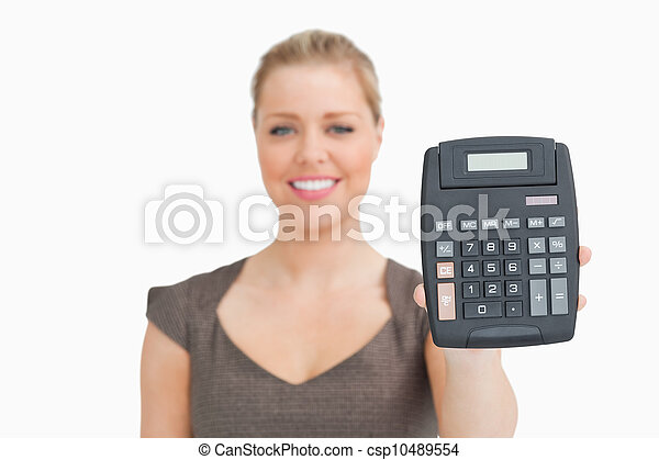 Woman showing a calculator in her hand - csp10489554