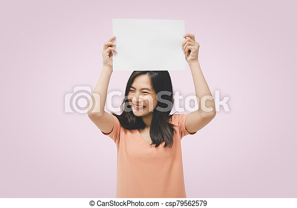 Woman showing blank white paper for copy space - csp79562579