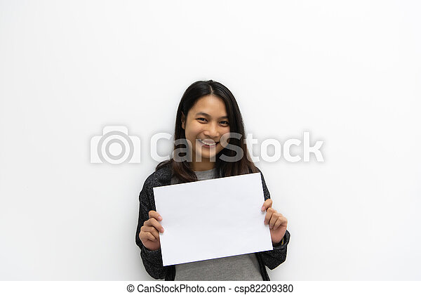 Woman showing blank white paper for copy space - csp82209380