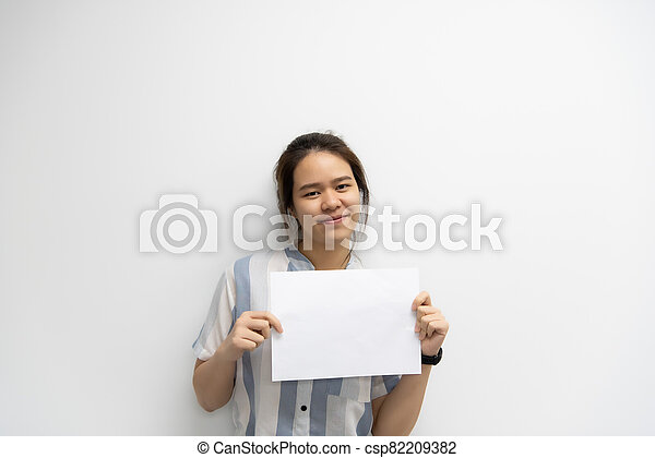 Woman showing blank white paper for copy space - csp82209382