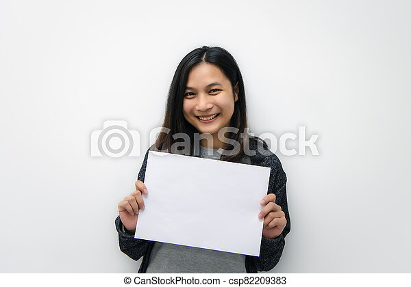 Woman showing blank white paper for copy space - csp82209383