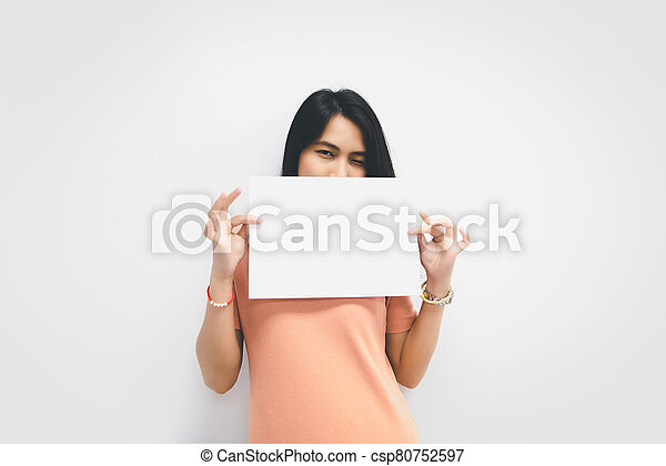 Woman showing blank white paper for copy space - csp80752597